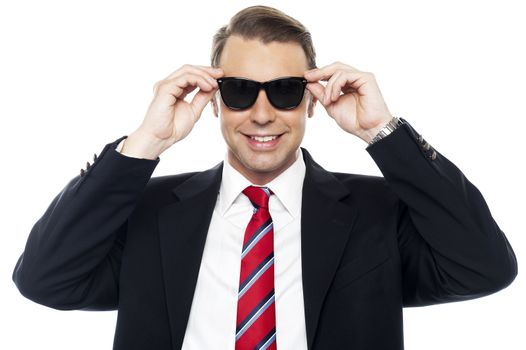 Stylish handsome businessman wearing shades
