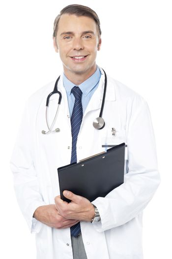 Smiling professional physician carrying clipboard