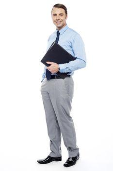 Handsome confident businessperson holding file folder