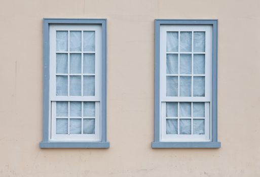Blue windows on a wall