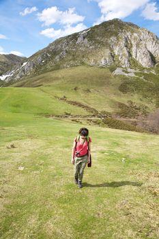 walking up on meadow at Picos de Europa