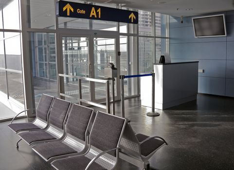 Empty seating at boarding gate at an airport