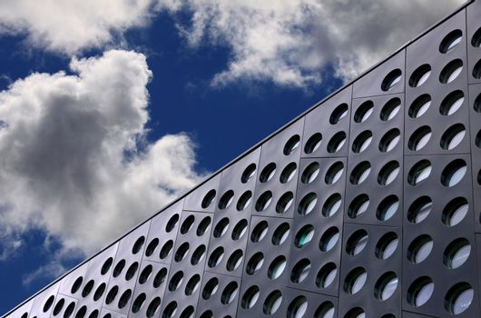Doted architecture detail against blue sky