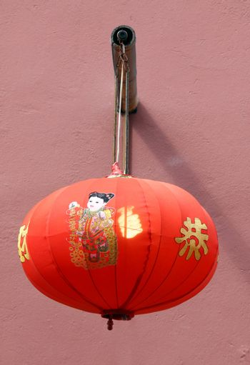 Traditional chinese lantern hanging on the wall