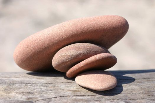 Four pebble stones pressing each other and collapsing, close-up picture
