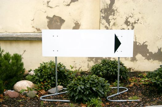 Blank bilboard on the street with pointing arrow