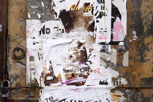 Rusty grunge door with old posters. Urban scene background