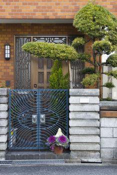 Entrance door with bonsai tree in Japan