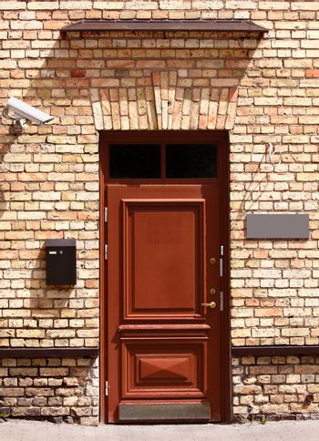 Outside office door with security camera, mailbox and empty signboard to add text