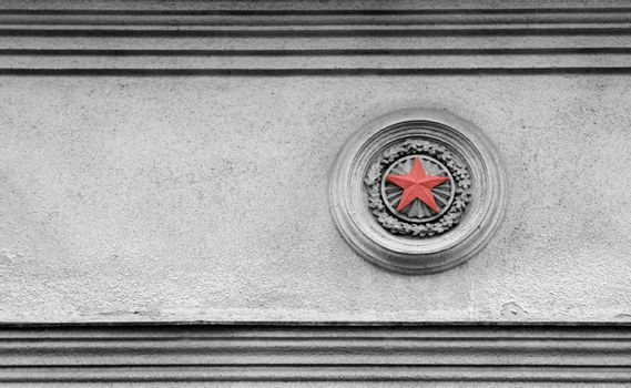 Black and white picture of Soviet times architecture exterior with red star detail