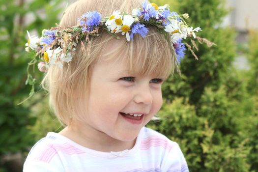 Portrait of smiling girl with flower crown on her head