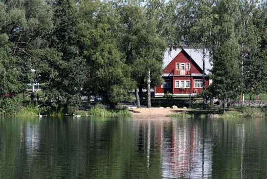 Remote summerhouse with reflection on the lake