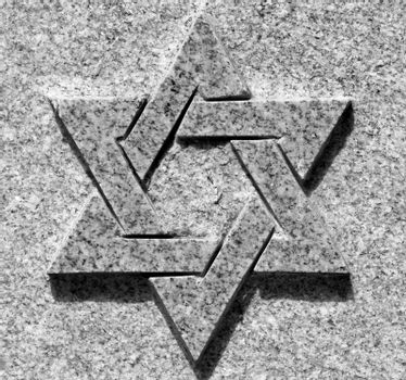 Black and white picture of star of David on the stone