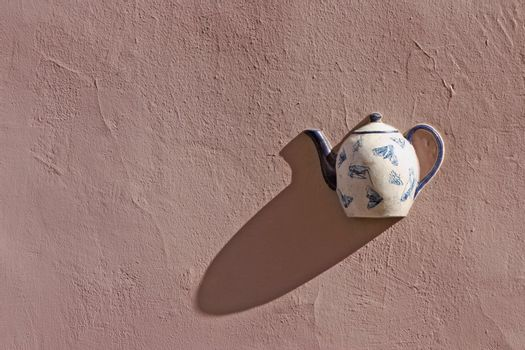 Nice teapot as wall decor detail in Vilnius old town, Lithuania