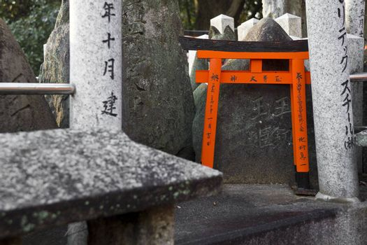 The small tori gate at Fushimi Inari Shrine in Kyoto, Japan.