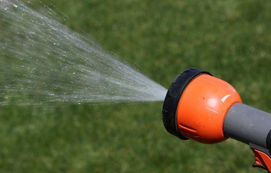 Closeup of the water sprinkler and splashing water