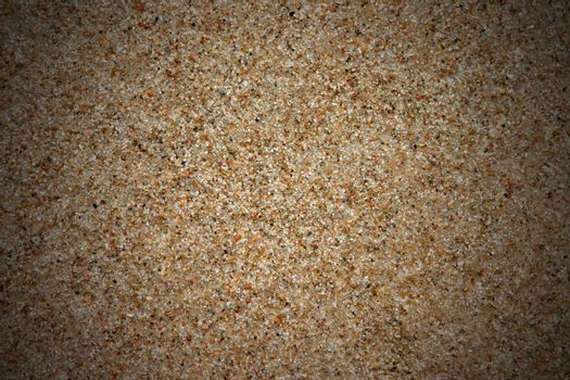 Vignetted sand background, natural texture, brown color, copy space