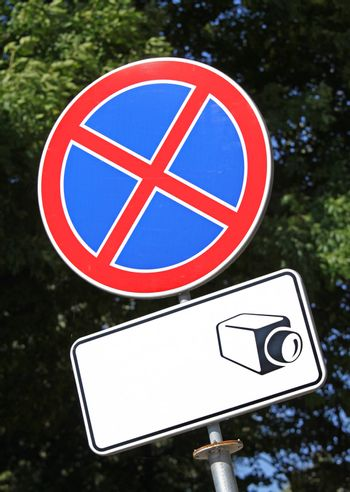 Warning road sign and display board with drawn camera icon. Still plenty of copy space to place text