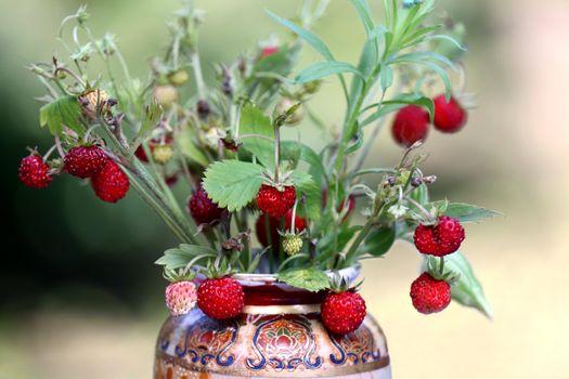 Wild strawberry bouquet daped in flower vase