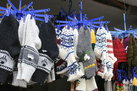 Colorful woven socks hanging for sale on the market