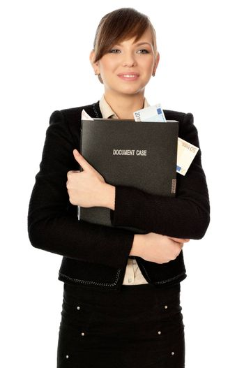 Business woman holding the document case with money in the hands as a symbol of wealth