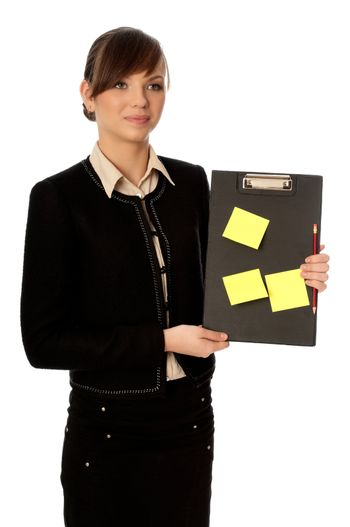 The office worker working in office and holding the document case with stickers in the hands
