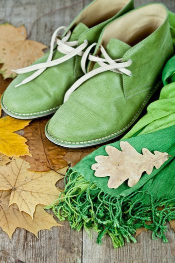 boots, scarf and yellow leaves