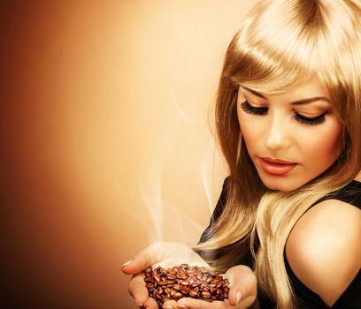 Beautiful woman holding coffee bean