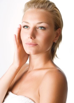 Beautiful Young Woman Touching Her Face. Perfect Skin