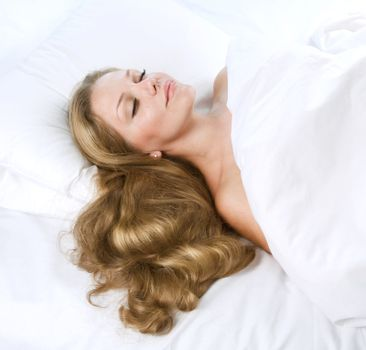 Beautiful Young Woman Sleeping In Her Bed