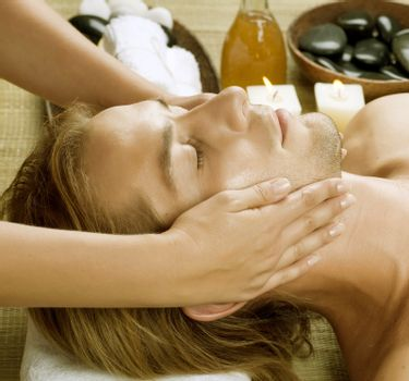 Spa. Young Man getting Face Massage