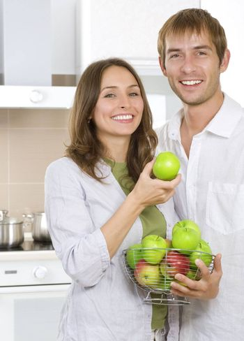 Couple eating fresh fruits.Healthy food.Diet.Kitchen