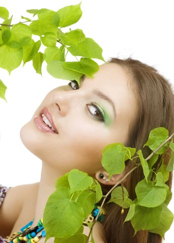 Beautiful Woman With Green Leaves. Natural Beauty. Healthy Skin
