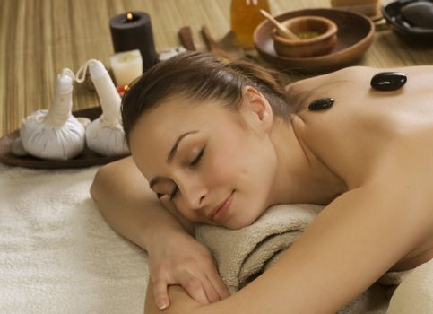Spa Woman. Hot Stones Massage