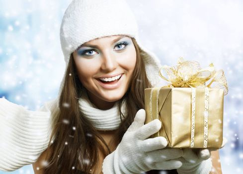 Beautiful Happy Girl with Christmas Gift. Snow