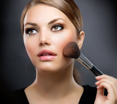Makeup. Applying Make-up Cosmetics Brush. Perfect Make-up