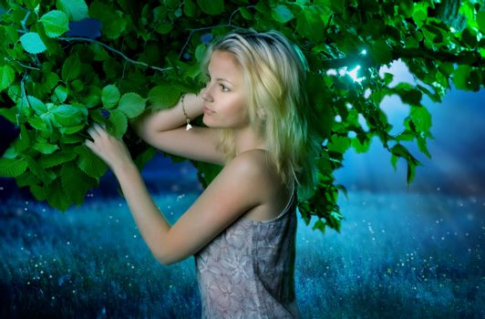 Beautiful girl in the fairy forest.Magic Night