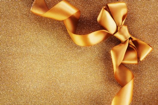 Holiday Background.Greeting Card.Gold Bow on a Blinking Backgrou