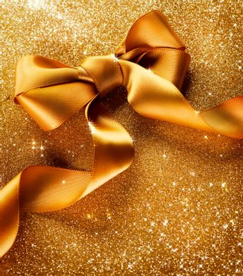 Gold Ribbon Bow on a Blinking Background Holiday Background.Gree
