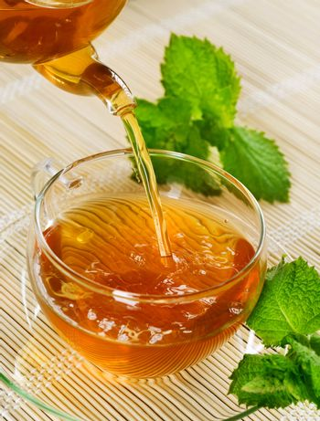 Pouring Healthy Tea With Mint