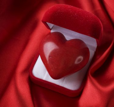 Valentine concept. Red velvet Gift Box with a heart