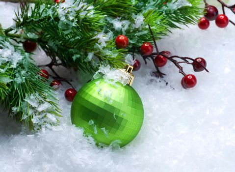 Christmas Bauble over Snow background