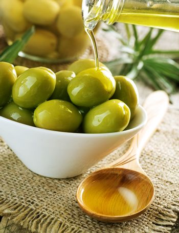 Olives And Pouring Olive Oil