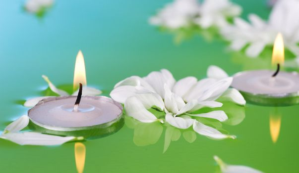 Burning Floating Candles And Flowers