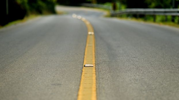 Yellow dividing line on the road