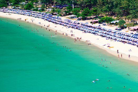 Crowd of tourists on the sandy beach of Phuket island, Thailand