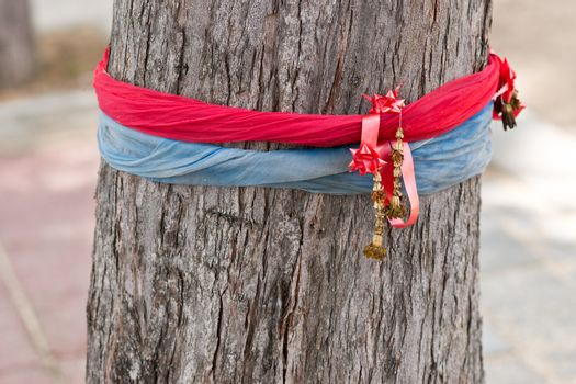Red and blue sacred ribbons on the tree