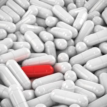 One red capsule in the heap of white capsules