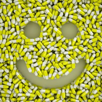 Happy smile made from many yellow pills, wellness concept