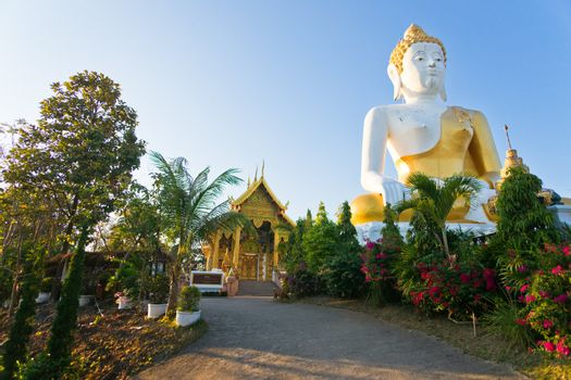 Statue of big Buddha in the temple Wat Doikam, Chiang Mai, Thailand